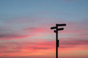 Crossroads sign on a beautiful sunset background